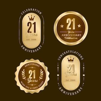 Kolekcja płaskich 21 rocznicowych złotych odznak