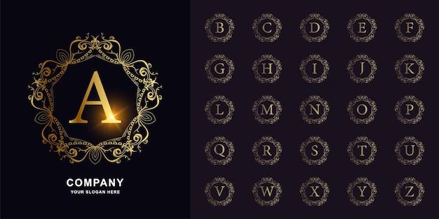Kolekcja początkowy alfabet z luksusową ramą kwiatowy ornament