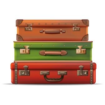 Kolekcja podróży walizek ułożonych jeden na drugim w skórę pojedynczo na białym tle