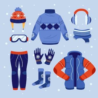 Kolekcja przytulnych zimowych ubrań płaska
