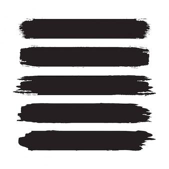 Kolekcja ręcznie rysowane streszczenie czarne pociągnięcia pędzlem. zestaw kształtów, ramek na białym tle