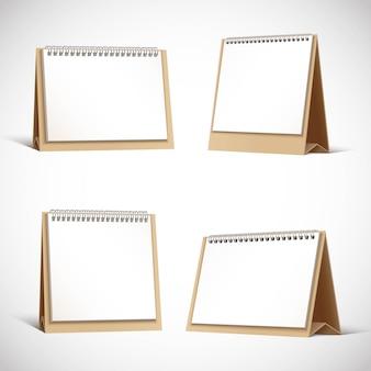 Kolekcja tekturowych planerów stołowych lub kalendarzy.