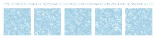 Kolekcja zimowych ozdobnych wzorów bez szwu