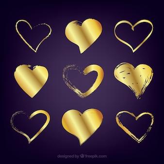 Kolekcja złote serce na białym tle