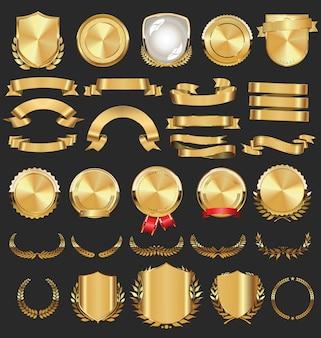 Kolekcja złotych odznak obejmuje tarcze laurowe i metalowe tabliczki