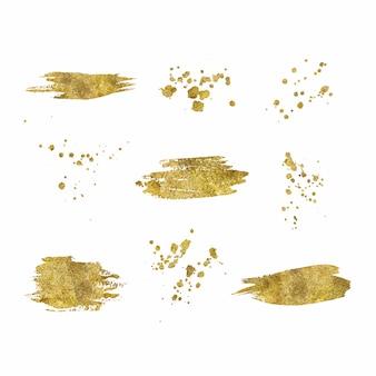 Kolekcja złotych pociągnięć pędzlem splatters na białym tle