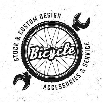Koło rowerowe i klucz wektor okrągłe godło, odznaka, etykieta lub logo w stylu vintage na białym tle na tle z wymiennymi teksturami grunge