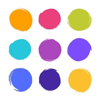 Koło teksturowanej ręcznie rysowane streszczenie kolorowe pociągnięcia tuszem zestaw na białym tle.