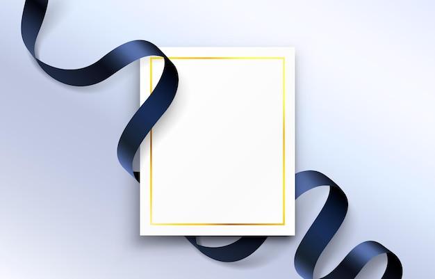 Kolorowa wstążka wokół papierowej ulotki, złota ramka.