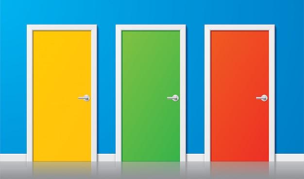 Kolorowe drzwi. zestaw nowoczesnych realistycznych drzwi w kolorze żółtym, zielonym i czerwonym z chromowanymi uchwytami na niebieskim tle ściany. ilustracja prostego projektu zamknęła drzwi w widoku z przodu. koncepcja wyboru.