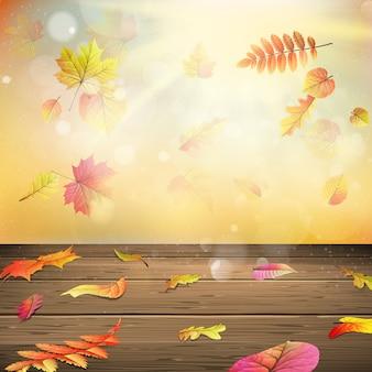 Kolorowe jesienne liście na deskach.