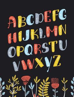 Kolorowe litery alfabetu boho. śmieszne wielkie litery abc na ciemnym tle