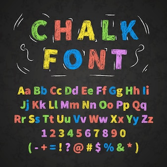 Kolorowe retro ręcznie rysowane alfabet litery rysunek kredą na czarnej tablicy