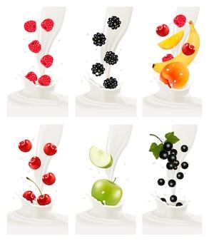 Kolorowe, świeże owoce wpadające w mleczny plusk.