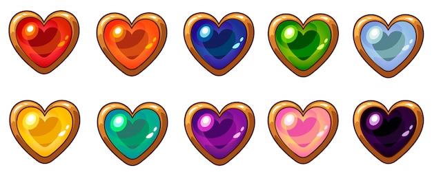 Kolorowy klejnot serca ze złotą ramą ustawiony na interfejs gry mobilnej