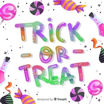 Kolorowy napis cukierek albo psikus z cukierkami