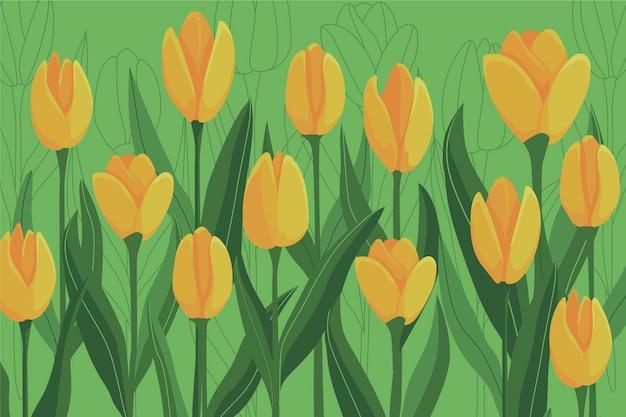 Kolorowy tło z żółtymi tulipanami i liśćmi