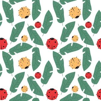 Kolorowy wektor wzór z biedronkami i liśćmi