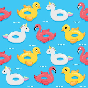 Kolorowy wzór nadmuchiwany pływanie. kształt flamingów, kaczek i jednorożców