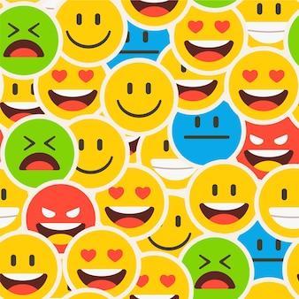 Kolorowy zatłoczony wzór emotikonów uśmiech