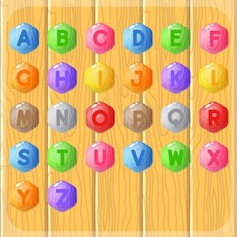 Kolorystyka drewna guziki alfabet od a do z gra słów w kształcie sześciokąta.