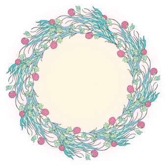 Kompozycja dekoracyjna z kwitnącą czerwoną koniczyną i krzyżem celtyckim. świąteczny projekt dnia świętego patryka.
