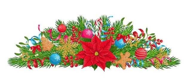 Kompozycja świąteczna z gałęziami jodły poinsettia bombki choinkowe jagody ostrokrzewu i pierniki