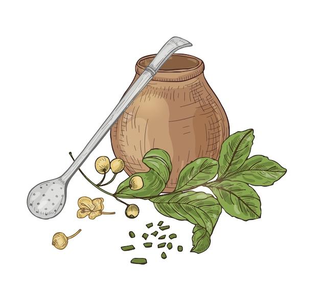 Kompozycja z herbatą mate w tradycyjnej tykwie, słomce bombilla, kwiatach i liściach