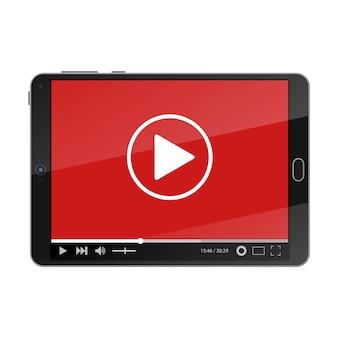 Komputer typu tablet z odtwarzaczem wideo na ekranie.