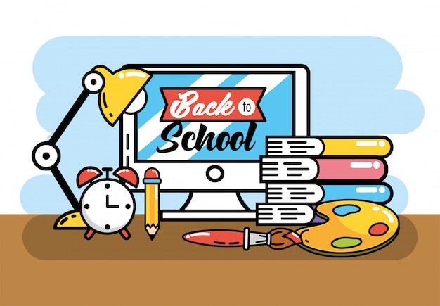 Komputer z książkami i ołówkiem, aby wrócić do szkoły