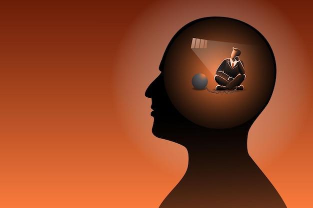 Koncepcja biznesowa, biznesmen w ludzkiej głowie jest uwięziony z żelazną kulą przykuty łańcuchem w nogach