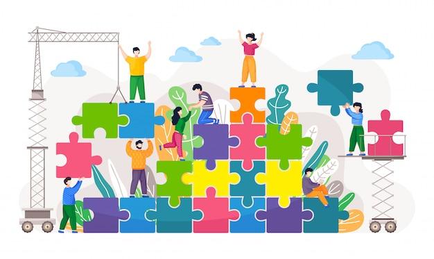 Koncepcja biznesowa coworkingu. współpracownicy montują układanki. metafora budowania zespołu