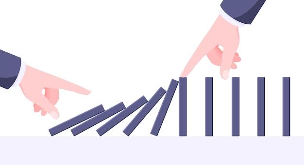 Koncepcja biznesowa efektu domina jedna ręka rozpoczyna reakcję łańcuchową spadających klocków do gry planszowej