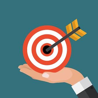Koncepcja biznesowa ręką biznesmena trzymać cel