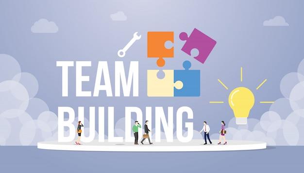 Koncepcja budynku zespołu z wielkim tekstem słowo i puzzle z zespołem ludzi firmy biurowej i żarówki