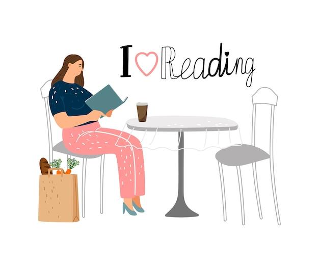 Koncepcja czytania. dziewczyna czytająca książkę w kawiarni ulicy.