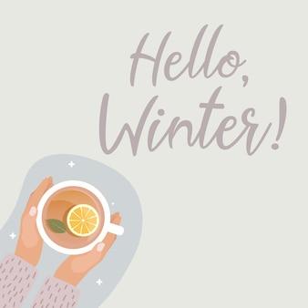 Koncepcja hallo winter. ręka z filiżanką gorącej herbaty
