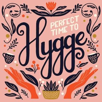 Koncepcja hygge. kolorowy napis i ilustracja
