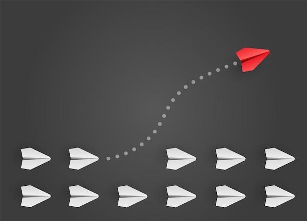 Koncepcja indywidualności. indywidualny i niepowtarzalny czerwony papierowy samolot lidera leci w bok. ilustracja