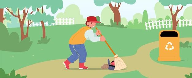 Koncepcja ochrony ekologii. chłopiec wolontariusz zamiata ziemię w parku zbierając śmieci do kosza na śmieci