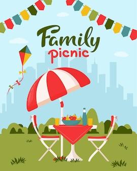 Koncepcja pikniku rodzinnego z serwowanym stołem
