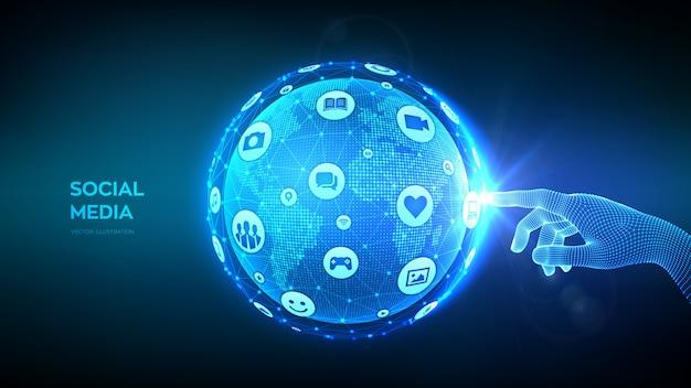 Koncepcja połączenia mediów społecznościowych. ręka dotyka abstrakcyjna kuli ziemskiej planety z ikonami mediów.