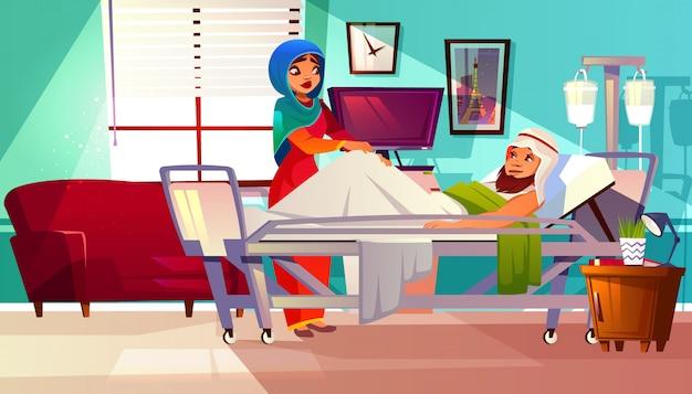 Koncepcja szpitala. arabski pacjent w łóżku z systemem podtrzymującym życie i muzułmańską pielęgniarką w hidżabie
