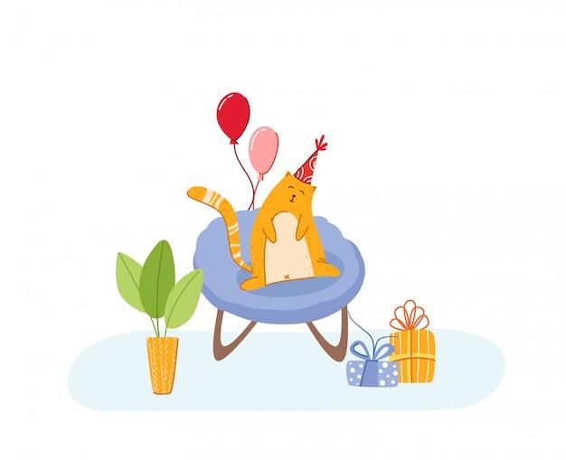 Koncepcja urodzinowa dla zwierząt domowych - czerwony kot w świątecznym kapeluszu na fotelu w przytulnym pokoju z wakacyjnymi dekoracjami