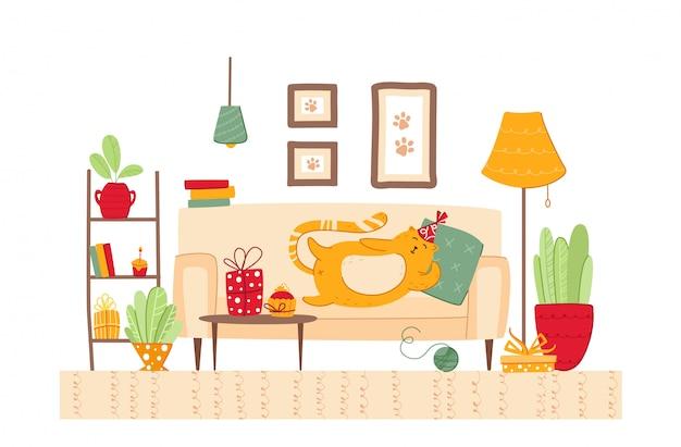 Koncepcja urodzinowa zwierzaka - gruby kot w świątecznym kapeluszu leży na kanapie i poduszce w przytulnym pokoju, pudełkach prezentowych i niespodziankach dla kociąt