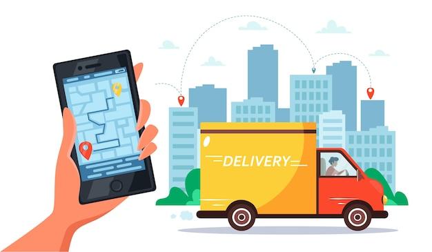 Koncepcja usługi dostawy ciężarówką, kurier jeżdżący ciężarówką, ręka trzymająca smartfon z możliwością śledzenia online.