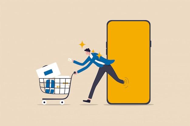 Koncepcja zakupów online lub aplikacji na zakupy mobilne, młody konsument posiadający koszyk kredytowy pchający pełne towary i paczki w wózku na zakupy biegnące ze strony internetowej lub aplikacji na smartfonie