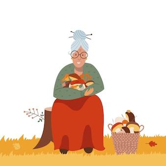 Koncepcja zbierania lub polowania na grzyby stara kobieta znajdująca grzyby w lesie aktywni seniorzy starsza la...