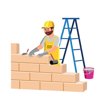 Konstruktor budynku ściana domu z cegieł wektor. przemysłowy murarz inżynier człowiek instalujący bloki na ścianie konstrukcyjnej za pomocą cementu i szpatułki. konstruktor postaci płaskie ilustracja kreskówka