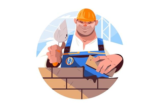 Konstruktor trzymający cegłę